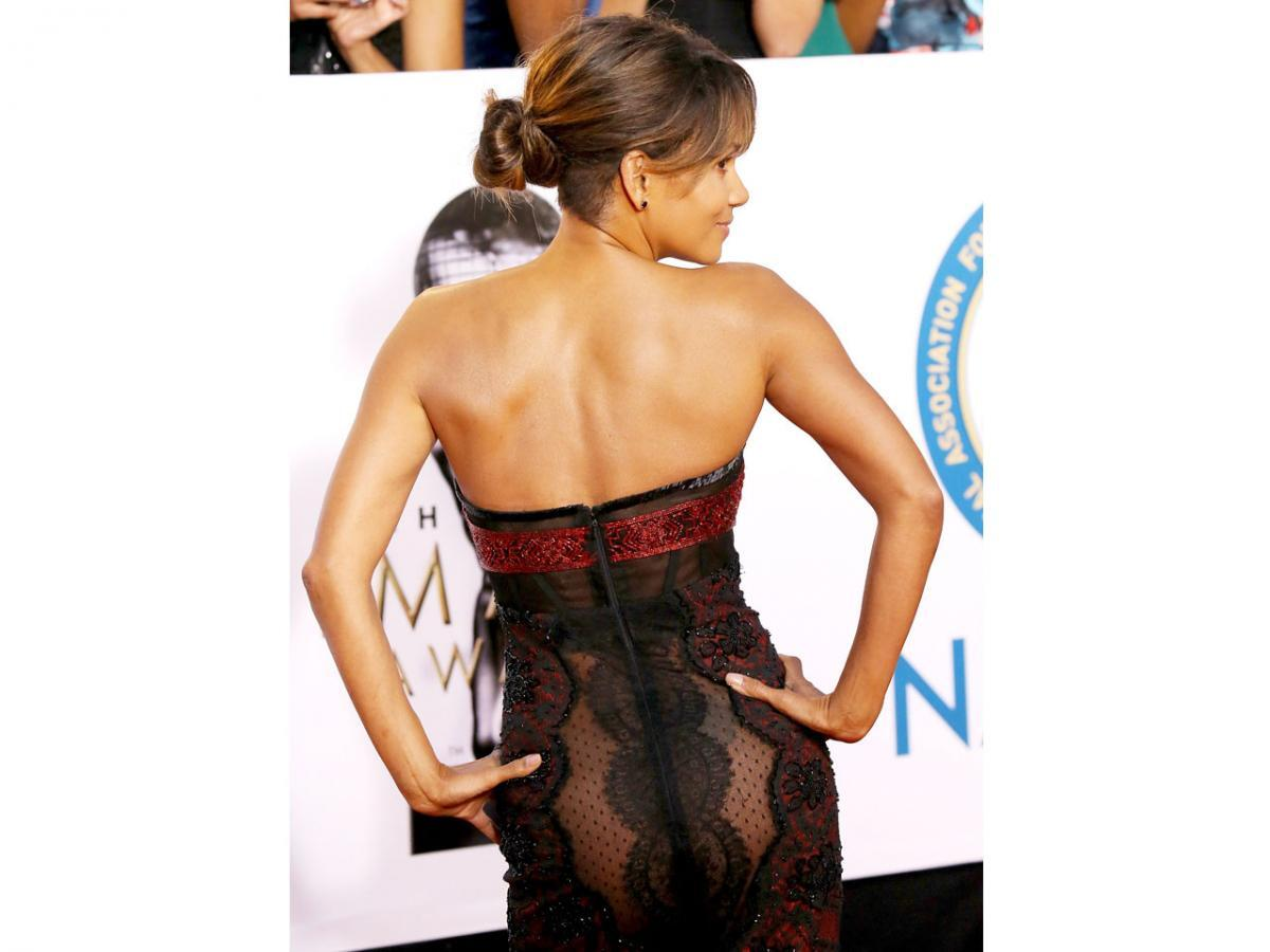 Halle Berry smolders in see-through dress